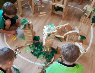 Children build their dream city with green buildings and neighborhoods